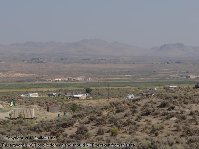 <B>A pretty view of the green valley floor that the N Fork of the Humboldt River flows thru and  Adobe Mountains beyond! On the right hand side of the pic is the town of Elko. Sweet investment property and gorgeous countryside for someone looking for a spot to build a home!