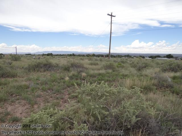 <B>Looking across the property to the power pole on the back side of these town lots in Carrizozo, New Mexico. The property sit on the edge of town in a cute neighborhood. The streets and sidewalk in front of the property were in the middle of being improved when we viewed it. And there