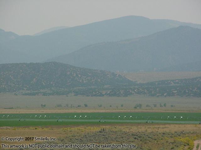 <B>This farm girl sure thought it was a gorgeous view of the green croplands being irrigated and the Culebra Range of the Sangre de Cristo Mountains stacked up beyond! It