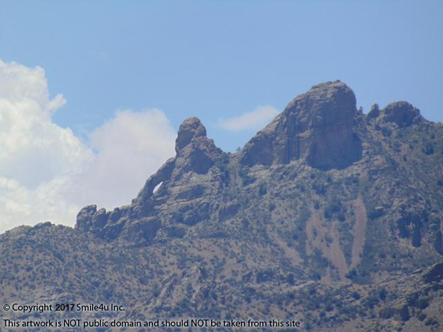 <B>Yep this does it for me, a view of Needles Eye in the Florida Mountains from 1 acre of land for sale on a graveled road with power along it about 12 miles from Deming, New Mexico! It about a mile from the foothills with a full view of Dragons Ridge! It