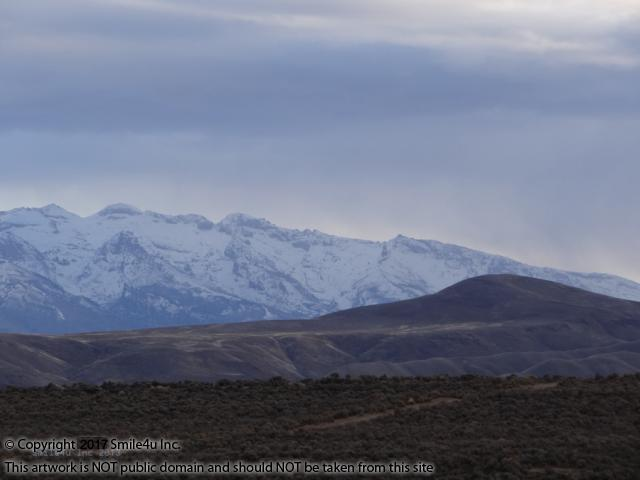 <B>Beautiful Views of the Ruby Mountains behind the Elko Hills in February 2015 from 1.03 acres of cheap land for sale in the Twin River Ranchos Unit 2 about 16 miles NE of Elko, Nevada! Called the Swiss Alps of NV, her snow capped peaks reach up to 11,317 feet at Ruby Dome.  Lovely! : ) <br /> <br /> Eastward I go only by force; westward I go free. Quote at the California Trail Interpretive Center by Henry David Thoreau.