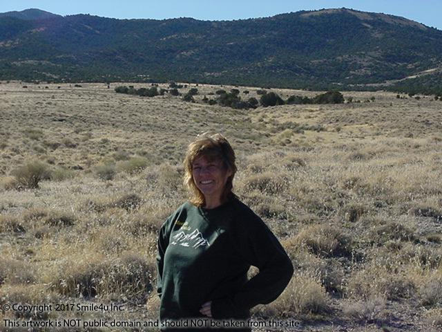 <B>Sporting my Montello, Nevada sweatshirt in front of the treed Toano Mountains from 10 acres of land for sale in NE Nevada Elko County - beautiful! I am sure to be the fashion envy of all! : )<br />