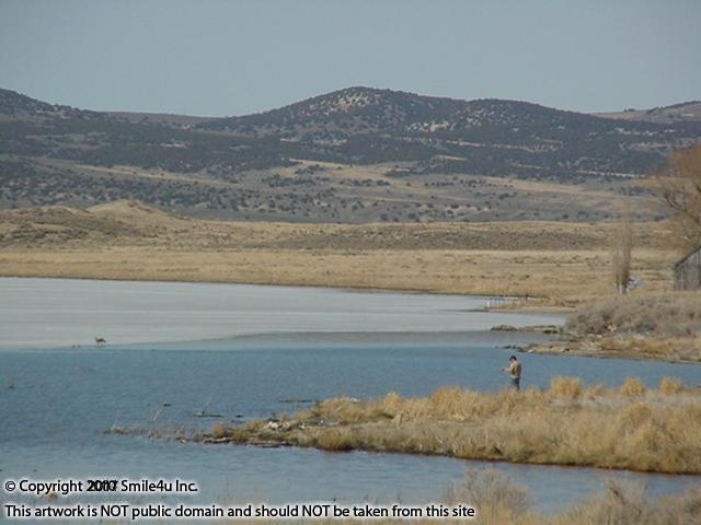 <B>I spotted someone fishing at South Fork Reservoir about 16 miles S of Elko. Part of the lake was still frozen. South Fork covers 1,650 acres and is surrounded by 2,200 acres of wildlife-filled meadow land and rolling hills. It