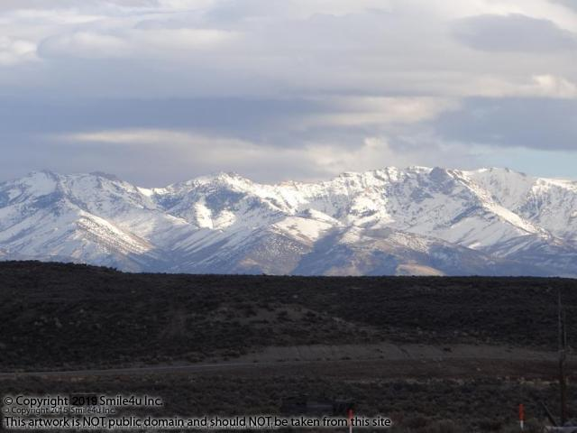 <B>2.27 acres of land with beautiful views of the snow capped Ruby Mountains from the lot for sale about 15 minutes NE of Elko, Nevada in Twin River Ranchos Unit 3. She towers above the Elko Hills! Called the Swiss Alps of Nevada, her snow capped peaks reach up to 11,317 feet at Ruby Dome. I own a piece of land a few miles N of here myself and hope to some day watch it snow on the Ruby Mountains! : )